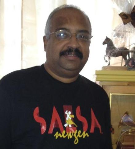 Pollo of El Gran Combo Wears The Official NewGenSalsa T-Shirt